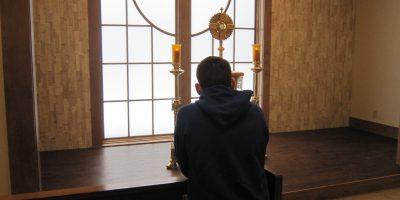 gentleman praying at chapel