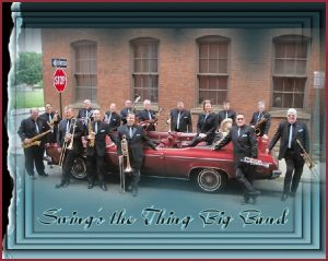 Swing's the Thing Big Band standing outside of a red car with their instruments